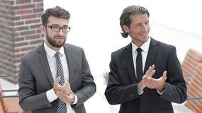 Business partners applauding ,standing in the office. Photo with copy space Royalty Free Stock Photos
