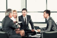Business partners approving the transaction with a handshake royalty free stock images