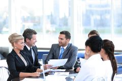 Business partners and business team discussing business issues. Stock Photos