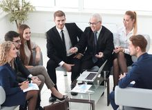 Business partners and business team discussing a new contrac Stock Images