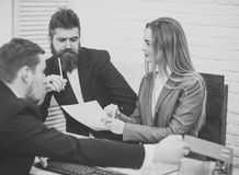 Business partners, businessmen at meeting, office background. Business negotiations, discuss conditions of deal. Woman lawyer explain terms of transaction Stock Images