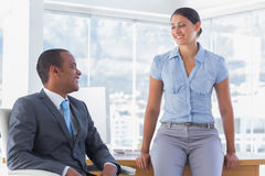 Business partners chatting and smiling Royalty Free Stock Photos