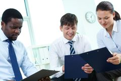 Business partners with clipboards Royalty Free Stock Image
