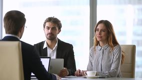Business partners closing deal with handshake at group negotiations. Business partners closing partnership collaboration deal with handshake at group stock video footage