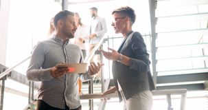 Business colleagues having conversation during coffee break Royalty Free Stock Images