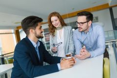 Business colleagues having conversation during coffee break Stock Image