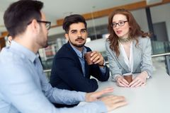 Business colleagues having conversation during coffee break Royalty Free Stock Image