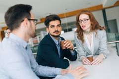 Business colleagues having conversation during coffee break Stock Images