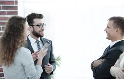 Business partners communicating before the start of the official meeting Stock Image