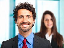 Business partners: couple of business people in the office stock photos