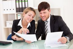 Business partners discuss sales Royalty Free Stock Image