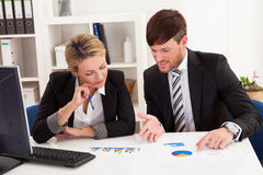Business partners discuss sales Royalty Free Stock Images