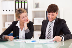 Business partners discuss sales Stock Images