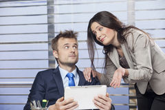 Business partners discussing. About the statistical data presented on tablet pc royalty free stock photography