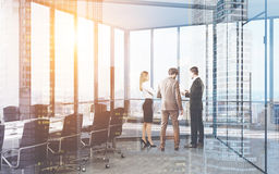 Business partners are discussing the agenda. Business partners are discussing project details in their office with large panoramic windows. 3d rendering. Toned Stock Photography