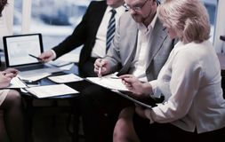 Business partners discussing contract terms in office royalty free stock images