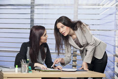 Business partners discussing documents. And ideas royalty free stock photography