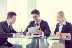 Business partners discussing documents and ideas Royalty Free Stock Image