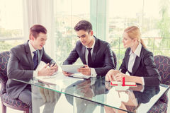 Business partners discussing documents and ideas Stock Photography