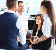Business partners discussing documents and ideas at meeting Stock Image
