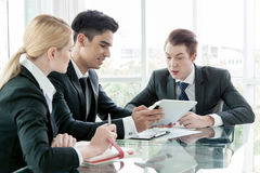 Business partners discussing documents and ideas at meeting Stock Photos