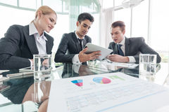 Business partners discussing documents and ideas at meeting Royalty Free Stock Photo