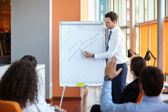 Business partners discussing. Documents and ideas at meeting in office stock images