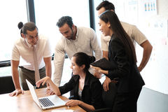 Business partners discussing documents and ideas. At meeting, using notebook; team meeting concept Stock Photography