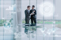 Business partners discussing documents and ideas in office, busi Royalty Free Stock Photos