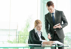 Business partners discussing documents and ideas in office Stock Image