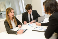 Business partners discussing documents Stock Photos