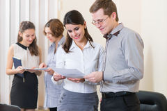 Business partners discussing documents Stock Images