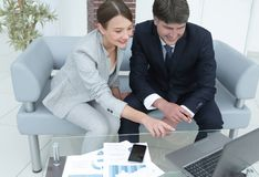 Two serious business partners discussing financial report. Business partners discussing financial report.photo with copy space Stock Images