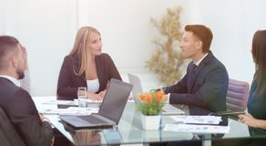 Business partners discussing a financial transaction. Sitting at your Desk Royalty Free Stock Photography