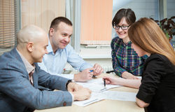 Business partners discussing ideas. At meeting indoors Stock Photography