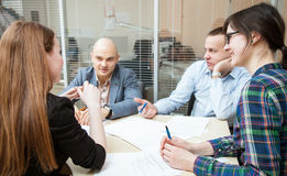 Business partners discussing ideas. At meeting indoors Royalty Free Stock Photography