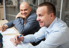 Business partners discussing ideas at meeting. Neutral background Stock Images