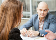 Business partners discussing ideas at meeting. Neutral background Royalty Free Stock Image