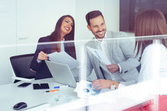 Business partners discussing ideas or project at meeting in office Stock Images