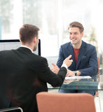 Business partners discussing in meeting hall Royalty Free Stock Image