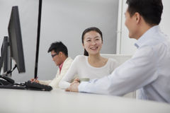 Business partners discussing in the office Stock Photography