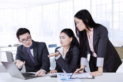 Business partners discussing in office Stock Photography