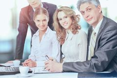 Business partners are discussing a plan of cooperation against the background of team work in office royalty free stock images