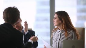 Business partners disputing on contract terms during group negotiation stock video footage