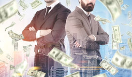 Business partners in a dollar rain, city Royalty Free Stock Image