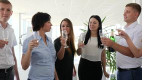 Business partners Drinking champagne and Make clinking glasses on work in modern office. Business partners Drinking champagne and Make clinking glasses in modern stock video footage