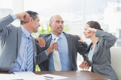 Business partners fighting together Royalty Free Stock Image