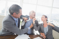 Business partners fighting together Stock Photos