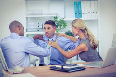 Business partners fighting together Stock Photo