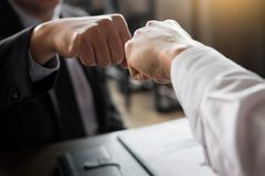Business Partners Giving Fist Bump to commitment Greeting Start stock image